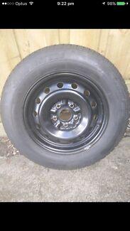 15 inch Ford/Toyota interceptor wheels as new and 15 inch Bridgestone