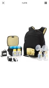 Brand new Medela  In Style Advanced Breast Pump with 100 Diapers