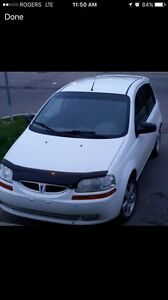 Lady driven 2006 Pontiac wave lots of work done