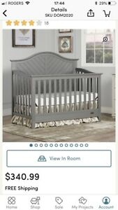Crib. Damage on wood rails and head board