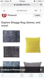 Used black shaggy rug- super low maintenance