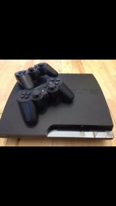 PlayStation 3 with 2 dual shock remotes.