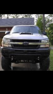 Very Lifted 2003 Chevy 1500 never seen salt.