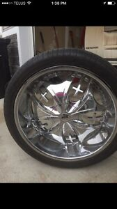 """Custom made 24"""" dubs and low profile tires"""