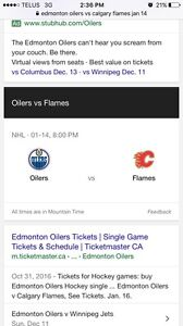 Edmonton vs Calgary ** first row behind oilers bench