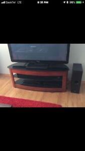 TV Stand. Like Condition. Sold Wood and Glass TV Not Included