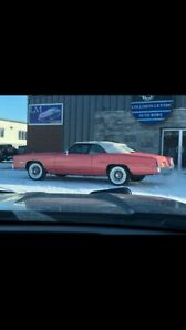 1975 coral Cadillac eldorado convertible parked for 25 years