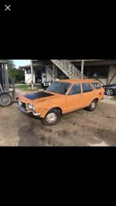 1973 Mazda rx3 wagon factory 12a 4 speed Herschel orange.