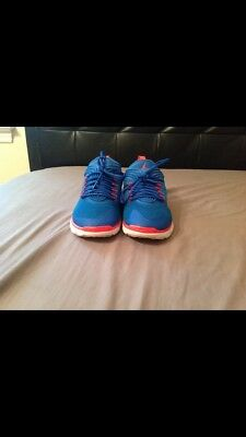 Used Low Top Blue White And Orange Jordans Size 10
