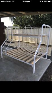 White tubular bunk beds double on the bottom single on the top $250