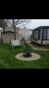 35 ft trailer, Florida room and shed, wildwood by the lake
