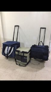 2 cooler bags on wheels and esky