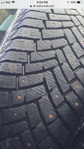 4 practically new studded snow tires and rims for Toyota corolla