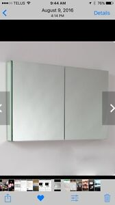 New mirrored medicine cabinet