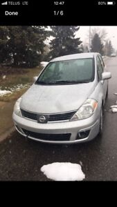 2009 Nissan Versa S 1.8 L Hatchback & Studded Winter Tires