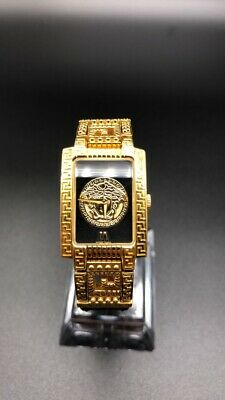 Gianni Versace Medusa Glod Plated Lady's Watch with original purchase receipt.