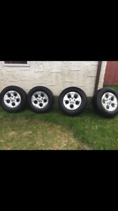 2015 Jeep Wrangler Stock rims with winter tires, 95% tread