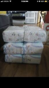 Huggies size 2 & 3 - willing to trade some for cloth diapers
