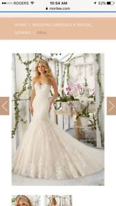 Brand new with tags size 14 Mori Lee wedding gown