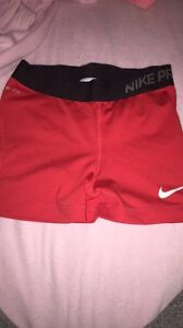 Red Nike shorts