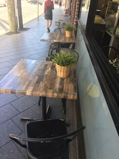 Wooden table tops with metal stands