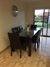 Chocolate brown dining table with glass top and 6 dining chairs Campbellfield Hume Area Preview