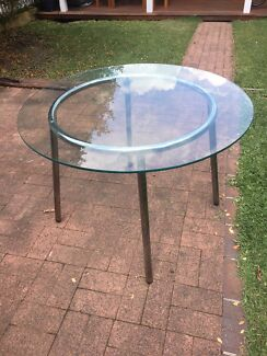 Glass dining table, round, steel legs, good condition