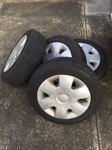 4x Suzuki swift wheels, tyres & hubcaps. 15inch 4x100 stud pattern. Bexley North Rockdale Area Preview