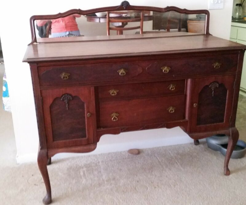 antique buffet cabinet with original mirror and cabriole legs