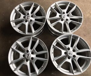 4 original Factory Nissan 18 inch Alloy with sensors