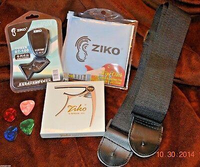 Guitar Gift Package Starter Kit - Tuner, Capo, Black Strap, Wipe Cloth, Picks