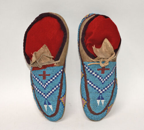 Antique Blackfeet Fully Beaded Moccasins with red cross and feather motif c.1890
