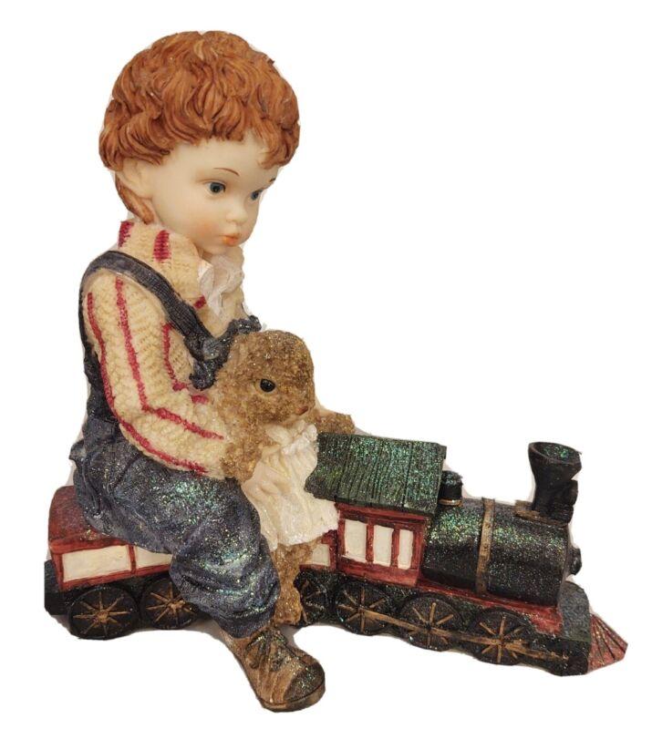 "Christmas Decoration Boy Riding Train Large Resin 10"" Tall x 10.5"" Long"