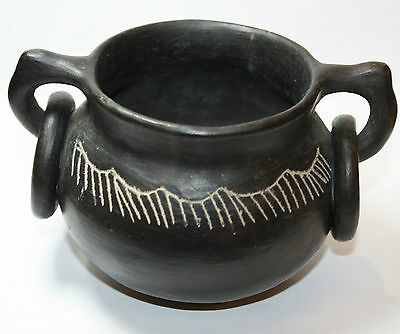 South American Costa Rica black ware twin handled vessel