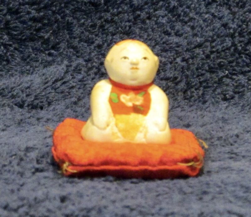 Antique Oriental Miniature Buddha Bisque Statue with Vintage Cloth Pillow