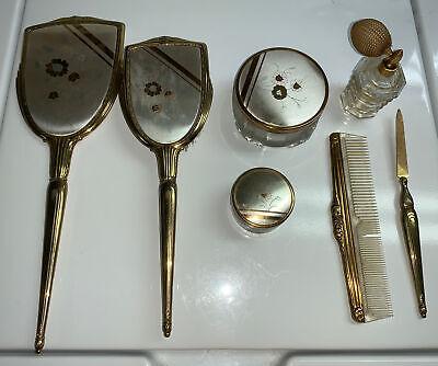 vintage mirror, brush, 2 powder boxes, comb, nail file and perfumn sprayer