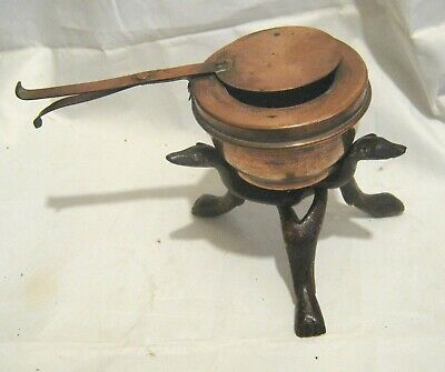 Great unusual small copper pan with brown wood stand dog head and feet design.