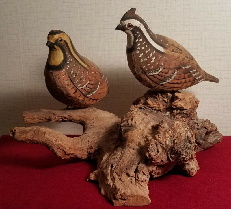 Carved pair of quail, signed by Walter T. Powell