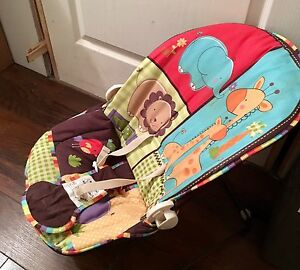 Baby bouncy chair with above musical mobile included