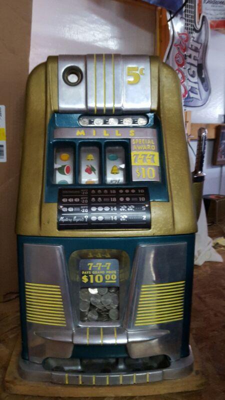 Mills 5-cent 777 hi-top antique slot machine plus stand