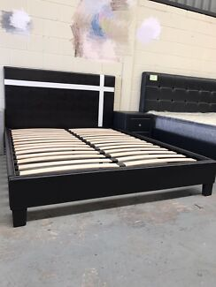 Brand new leather bed frame with super strong slats D$150,Q$170