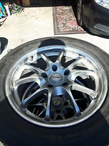 "Four 17"" Universal Chrome  Rims an tires  $450.00. OBO"