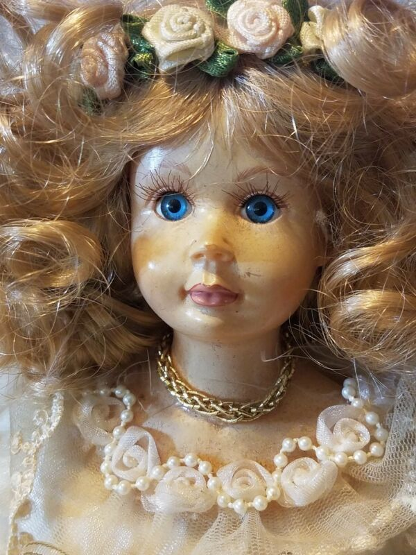 Porcelain Angel Doll Shelf Sitting Blonde Hair Blue Eyes Gold Dress Feather Wing
