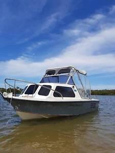 4.5m Half Cabin Boat and trailer