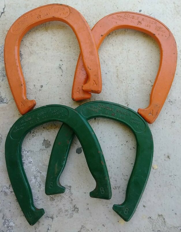 Older pair of DIAMOND DOUBLE RINGER HORSESHOES Duluth 2 1/2 lbs orange green USA