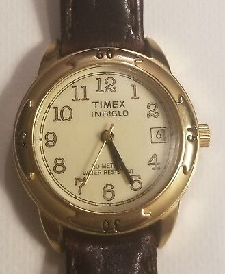 Timex indiglo womens watch. In excellent condition. Very fancy face and case. Case Shape Womens Watch