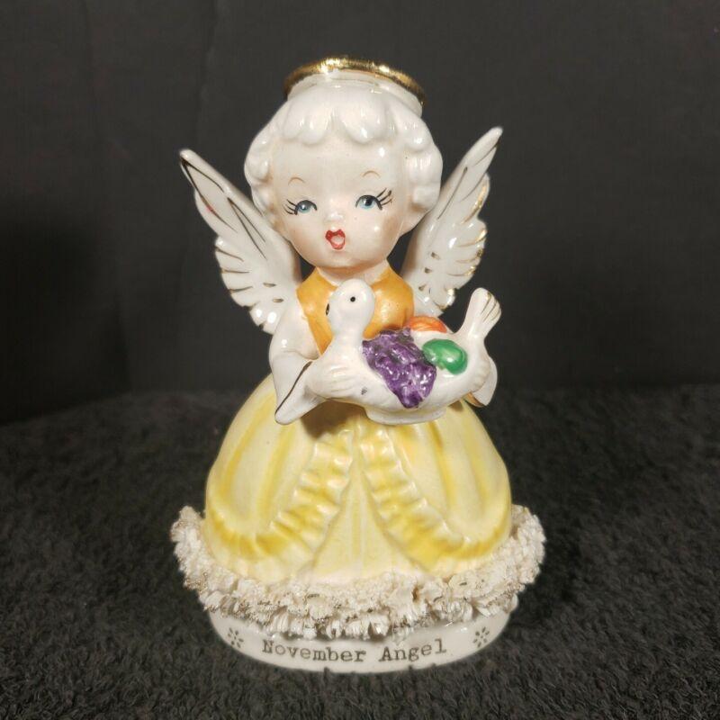 "Vintage Made In Japan November Angel Figurine 4 1/8"" Tall"