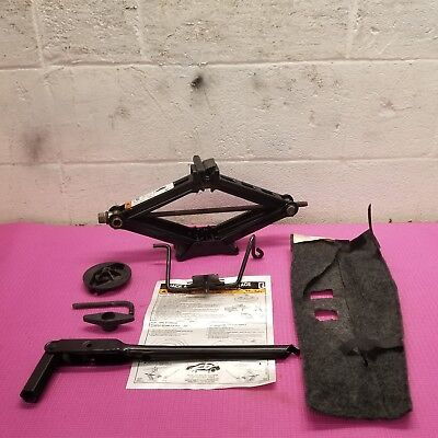 -  05 06 07/06 FORD FREESTYLE  SPARE TIRE JACK KIT WITH HOLD DOWNS.