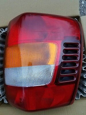 1999-2004 Jeep Grand Cherokee RH passenger side Tail Light assembly OEM - used