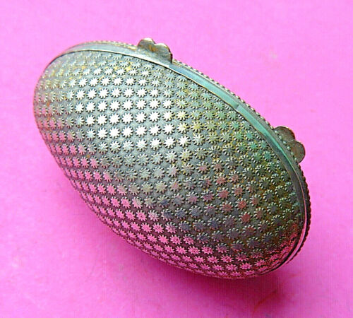 ANTIQUE METAL SEWING THIMBLE IN EGG SHAPED RAISED  FLORAL DECORATED CASE.
